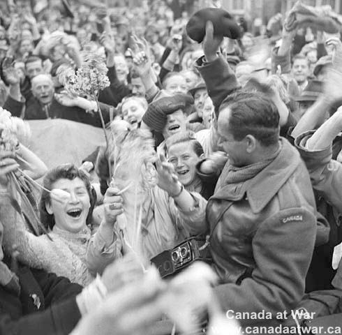 Dutch civilians celebrate the liberation of Utrecht by the Canadian Army, May 1945.